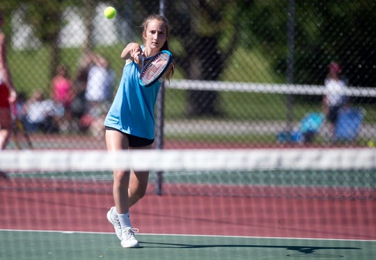 South Burlington's Izzy Partilo connects on a stroke in her victory during the Division I girls tennis state championship match in Shelburne on Thursday, June 6, 2019.