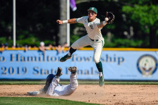 Delbarton's Anthony Volpe (7) reaches for the ball as St. Augustine's Kevin Foreman (10) slides safe into second at Veterans Park in Hamilton Township Thursday, June 6, 2019. Delbarton won 4-3, earning a Non-Public A state championship tittle.