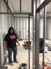 Tiffany Sandt  stands in the future cake room of the Cherry Hill Sweet & Sassy. The new location will be among the first to feature an updated look when it opens this summer in the Ellisburg Shopping Center.