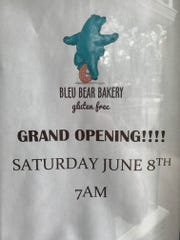 A happy bear riding a doughnut unicycle announces the arrival of Bleu Bear Bakery, a gluten-free business opening on Kings Highway in Haddonfield.