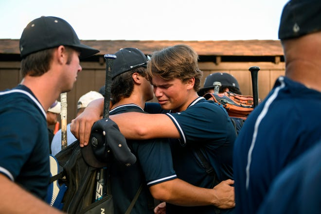 St. Augustine's Robert Ready (12) is embraced following a 4-3 loss against Delbarton at Veterans Park in Hamilton Township Thursday, June 6, 2019. Delbarton earned their second Non-Public A state championship tittle in three years.