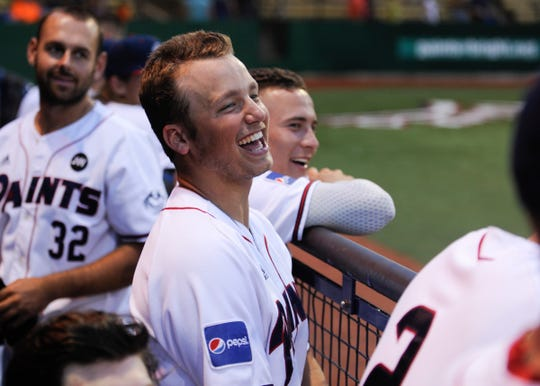 Cole Andrews jokes with fans and his teammates during a 10-3 win over Terre Haute on June 6. Andrews had a big year in his freshman season at Miami, now that success is carrying over to his summer with the Chillicothe Paints.