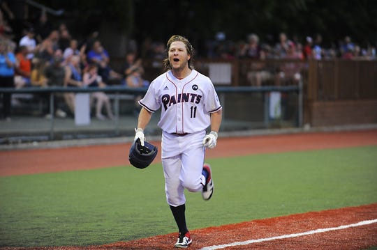 Trey Smith celebrates after hitting a grand slam on June 6 against the Terre Haute Rex at VA Memorial Stadium. Smith hit a grand slam on Tuesday to help the Paints win the 2019 Prospect League Championship.