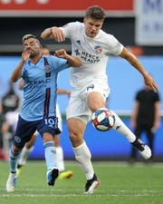 Jun 6, 2019; New York, NY, USA; New York City FC midfielder Maximiliano Moralez (10) and FC Cincinnati defender Nick Hagglund (14) fight for the ball during the first half at Yankee Stadium. Mandatory Credit: Brad Penner-USA TODAY Sports