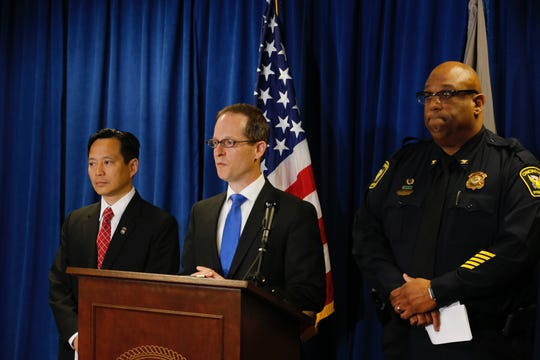 U.S. Attorney Benjamin C. Glassman, center, speaks during presser. William Cheung, Acting Special Agent in Charge, IRS Criminal Investigation, left, and Cincinnati Police Chief Eliot K. Isaac.