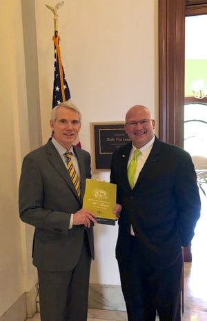 MN8 Founder and veteran Zachary Green and Ohio Senator Rob Portman with the Exporter of the Year Award received in Washington, D.C.