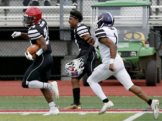 East running back Nak'emon Williams, from Kings, runs for a touchdown against West during the SWOFCA East-West All-Star game at Kings Thursday, June 6, 2019.