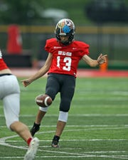 Ryle kicker Mason Molique punts for the East at the Saint Elizabeth Health Care Northern Kentucky All-Star Football game at Dixie Heights High School June 6.