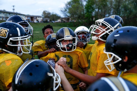Boys in the 9-12 age group gather around and yell their team chant at the end of practice for the Clarksville Screaming Eagles youth football team at Bel Aire Park in Clarksville, Tenn., on Thursday, April 11, 2019.