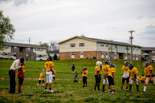 Pooky Bogerty speaks to his quarterback during an afternoon practice at Bel Aire Park in Clarksville, Tenn., on Thursday, April 11, 2019.