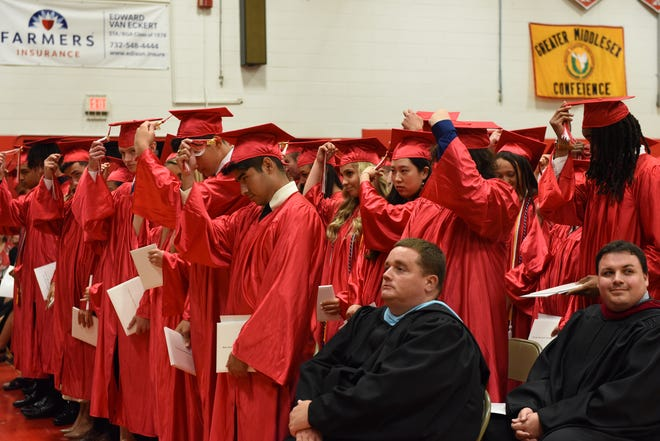 The Bishop George Ahr High School, Edison, Class of 2019 turns their tassels after they receive their diplomas at the Saturday, June 1, commencement exercises held at the school.
