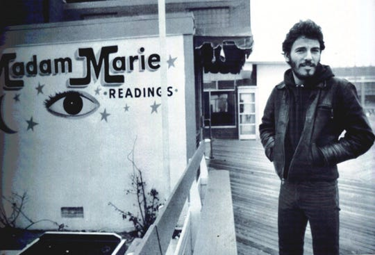 Bruce Springsteen stands in front of Madam Marie's on the Asbury Park boardwalk in the '70s.