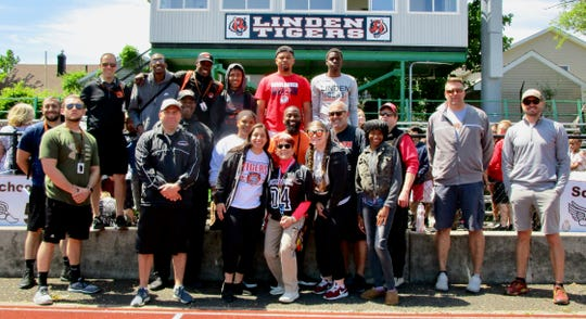 Linden Public Schools physical education staff and varsity track and field athletes who helped organize and run the Paul Blue Elementary Track and Field Meet.