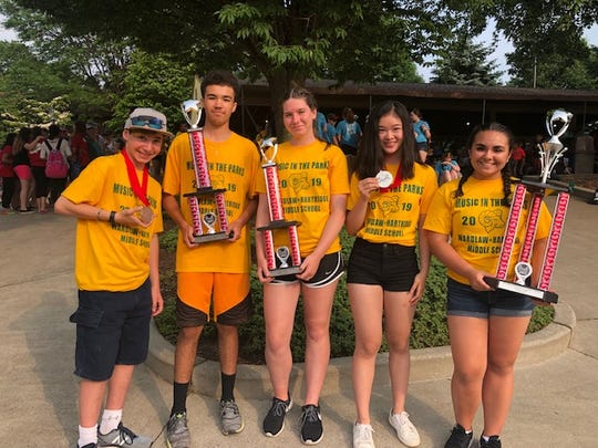 David Ezra Flatau-Jones of Scotch Plains, Matt Piccoli of Somerset, Caroline Parker of South Plainfield, Annie Gu of Edison and Kapriana Payami of Scotch Plains proudly display the W+H trophies and medals.