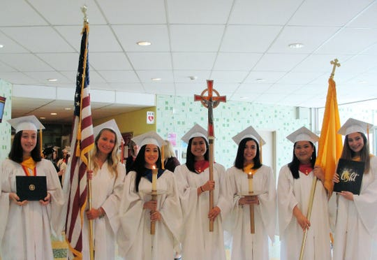 Mother Seton Regional High School 2019 Commencement. (Left to right)  Grad 2: Victoria Silverman, Jenna Mikolay, Thalia Lantin, Mariella Brillantes, Andrea Sanchez, Isabella Felix and Hanna Campiglia.