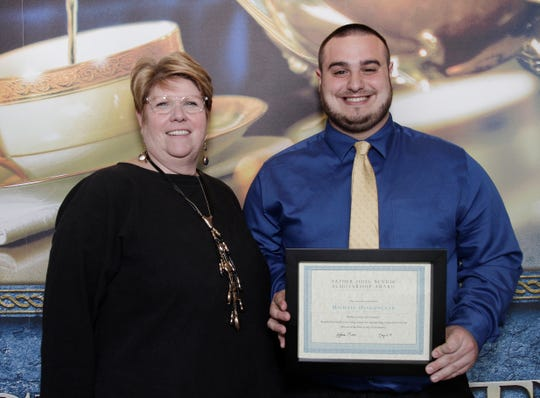 "Kathleen ""Kit"" Foley, vice president of Student Life (left) presents the Father John Bendik Scholarship Award to Michael Diakunczak of Edison, during the 36th annual Student Leadership awards dinner on campus."