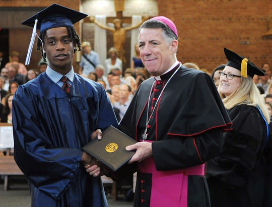 Bishop James F. Checchio presents diplomas to the Immaculata High School, Somerville, Class of 2019 seniors during the Friday, May 31, commencement exercises held at Immaculate Conception Parish, Somerville.