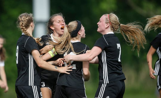Members of the Ankeny Centennial girls soccer team  celebrate a goal against Council Bluffs Abraham Lincoln during the semifinals of the 2019 Iowa high school girls state soccer tournament at Cownie Soccer Complex in Des Moines on Thursday, June 6, 2019.