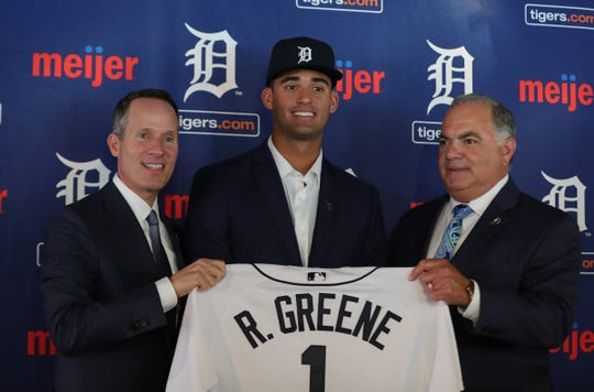 Tigers owner Christopher Ilitch, first-round draft pick Riley Greene and GM Al Avila on Friday at Comerica Park.
