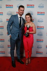 Detroit Red Wings center Dylan Larkin with I Am Sport Award, Jacqueline Taylor of Chelsea, Thursday, June 6, 2019 at the Fillmore Detroit.