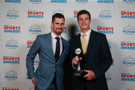 Colin Czajkowski with Red Wings center Dylan Larkin on Thursday at the Fillmore.