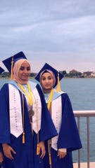 Zainab Altalaqani, 18, left, and Tuhfa Kasem, 17, of Detroit were both named salutatorian at Universal Academy. They used their graduation ceremony speeches to blast their school.