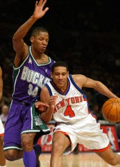 New York Knicks' Howard Eisley tries to get by Milwaukee Bucks' Ray Allen in New York on March 5, 2002.