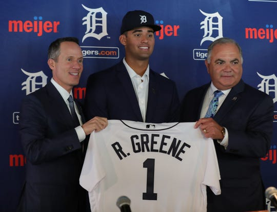 Detroit Tigers owner Chris Ilitch, 2019 first-round draft pick Riley Greene and GM Al Avila on Friday, June 7, 2019 at Comerica Park in Detroit.