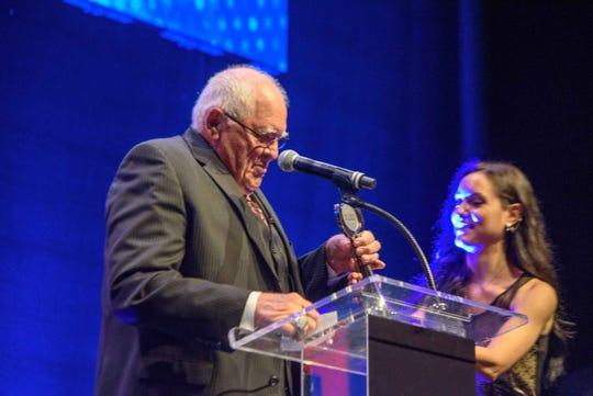 Farmington Hills Harrison football coach John Herrington receives the Lifetime Achievement award during the Detroit Free Press Sports awards at the Fillmore on Thursday, June 6, 2019.