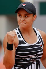 Australia's Ashleigh Barty clenches her fist after scoring a point against Amanda Anisimova of the U.S. during their semifinal match Friday.