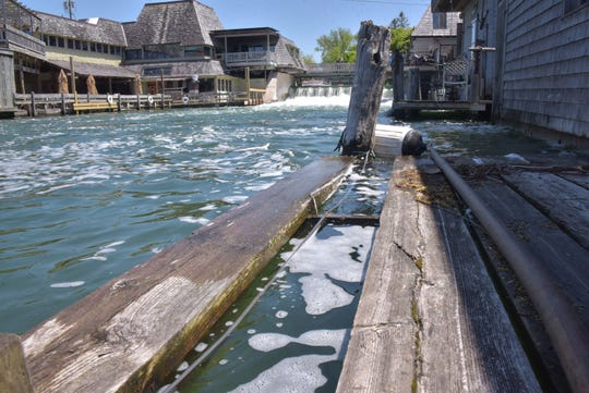 Some boardwalks are under water in Leland's Fishtown, which faces near-record water levels, fed by Lake Michigan.