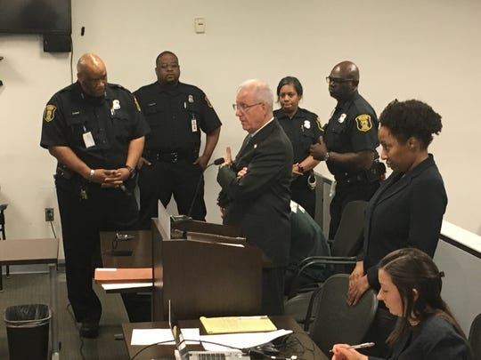 Court officers surround defendant Allivas Kyles after he became argumentative during his preliminary examination in 36th District Court, where he is charged with second-degree murder for allegedly causing a crash that killed two people