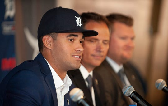 Tigers' first-round draft pick Riley Greene takes questions from reporters, along with Tigers scouts Scott Pleis, right, and RJ Burgess, far right.