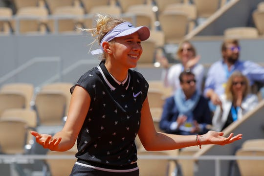 Amanda Anisimova of the U.S. celebrates winning her quarterfinal match of the French Open tennis tournament against Romania's Simona Halep in two sets, 6-2, 6-4.