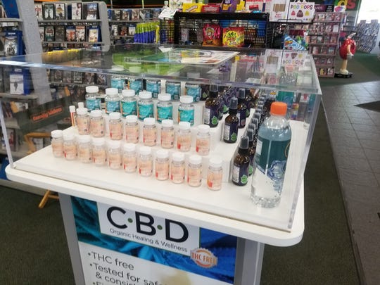 A display case at a Family Video in Waterford Township shows off bottles of CBD-infused gummy bears, sprays, water and lip balms from Oklahoma-based Natural Native that have no psychoactive elements.