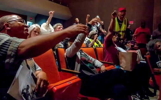 "The crowd shouts ""No justice, no peace"" at  the Benton Harbor School Board's special meeting to discuss the state's proposal to close the high school on June 4."