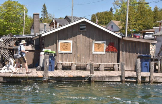 Leland's Fishtown, where some shanties along the iconic river have been close to flooding this spring, is threatened by Lake Michigan's ever-increasing water levels.