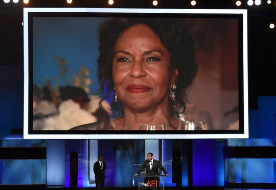 Pauletta Washington, wife of actor Denzel Washington, is seen on a video monitor as her husband accepts the 47th AFI Life Achievement Award.