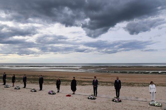 From the right, U.S House Speaker Nancy Pelosi, French Prime Minister Edouard Philippe, Canadian Prime Minister Justin Trudeau, Britain's Defence Secretary Penny Mordaunt and Dutch Defence Minister Ank Bijleveld an other officials attend an international ceremony on Juno Beach in Courseulles-sur-Mer, Normandy.