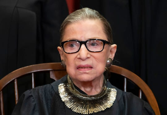 In this Nov. 30, 2018 file photo, Associate Justice Ruth Bader Ginsburg sits for a portrait at the Supreme Court Building in Washington. Ginsburg hinted that sharp divisions will mark the final weeks of a Supreme Court term that will include major rulings on the census and partisan gerrymandering.