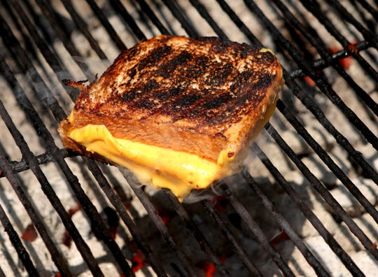 Avoid unnecessary fat and calories by grilling an American cheese sandwich with white bread on the barbecue.