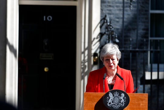 In this Friday, May 24, 2019 file photo, British Prime Minister Theresa May reacts as she makes a speech in the street outside 10 Downing Street in London, England. May has steped down as Conservative Party leader on June 7 and will serve as caretaker prime minister until her successor is chosen.