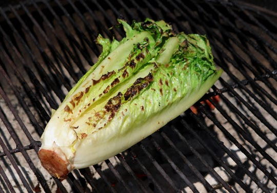 Grilled romaine lettuce pairs nicely with Caesar dressing.