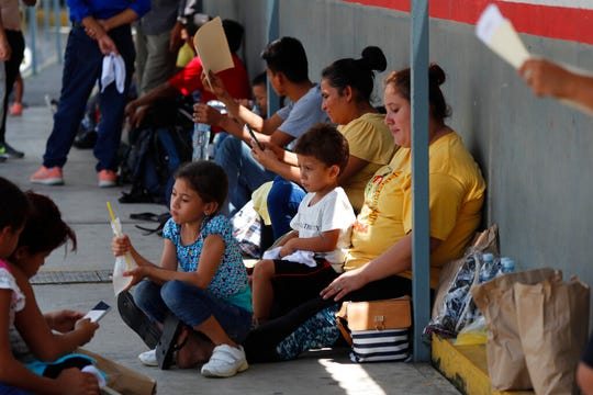 Central American migrants wait to enter Mexico legally, outside a Mexican immigration control center on Mexico's southern border with Guatemala, near Ciudad Hidalgo, Mexico, Thursday, June 6, 2019. On Wednesday, Mexican police and immigration agents blocked the advance of about 1,000 Central American migrants who were walking along a highway in southern Mexico.