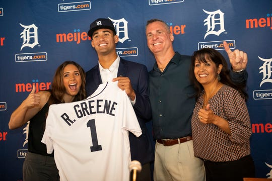 Detroit Tigers first-round draft pick Riley Greene poses with family members (from left), sister Miranda, father Alan and mother Lisa at the end of Greene's introductory press conference at Comerica Park on Friday.