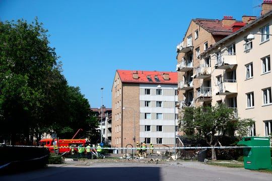 Rescue personnel outside a block of flats that were hit by an explosion, in Linkoping, Sweden.