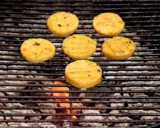 Seasoned polenta slices take on extra flavor when cooked on the barbecue grill.