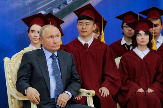Russian President Vladimir Putin attends the ceremony of presenting Chinese President Xi Jinping degree from St. Petersburg State University at the St. Petersburg International Economic Forum.