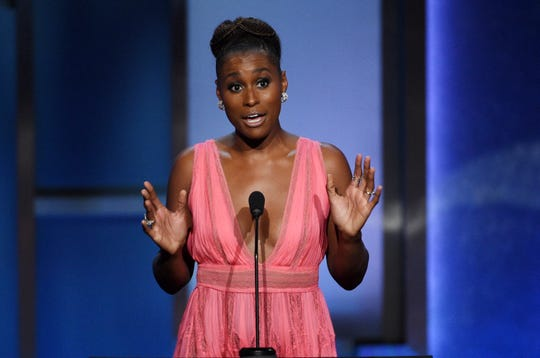 Actress Issa Rae speaks from the podium.
