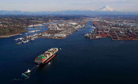In this March 5, 2019, file photo, a cargo ship arrives at the Port of Tacoma, in Tacoma, Wash. President Donald Trump's trade wars have already wiped out all but $100 of the average American household's windfall from Trump's 2017 tax law.